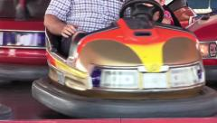 People ride in electric bumper cars at summer amusement park 01 Stock Footage