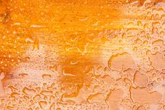 Abstract raindrops pattern on wooden board Stock Photos