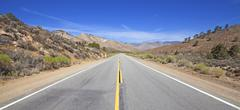Panoramic country highway in USA, travel adventure concept. Stock Photos