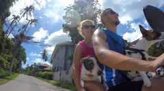 Happy Couple on Scooter with Puppy Dog Stock Footage