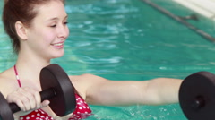 Woman doing aqua aerobics with trainer Stock Footage