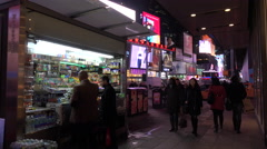 Stock Video Footage of Nighttime crowds of people and bright neon advertisements in Times Square, New