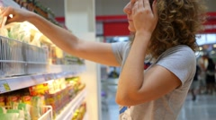 Woman Choosing Products in Supermarket Stock Footage