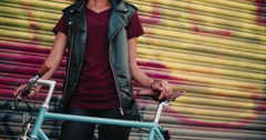 Girl's hands on the handlebar of classic fixed gear bike - stock footage