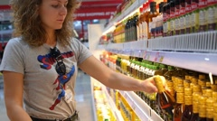 Woman in the Supermarket Shopping for Food, Olive Oil Stock Footage