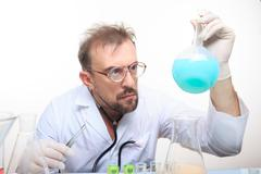 Mad chemist in the lab doing reaction - stock photo