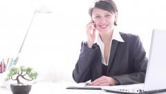 Businesswoman working, get good news, phone, shocked, looking at camera smiling Stock Footage
