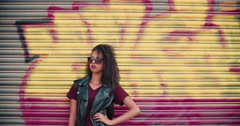 Confident African American girl in sunglasses with urban graffitti Stock Footage