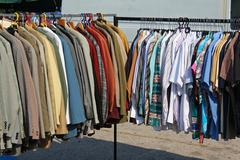Stock Photo of Second hand worn clothes sold on flea market