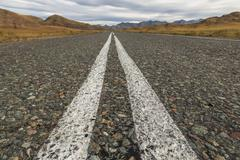 Stock Photo of Asphalt road in the highlands