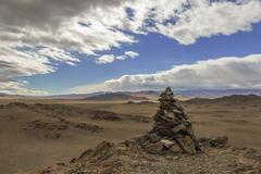 A pile of stones ritual in Mongolia - stock photo