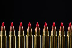 Top croped cartridges ranked with red tip - stock photo