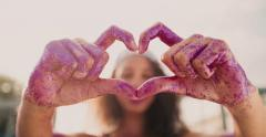 Girl holding up hands in heart shape with sun flare Stock Footage