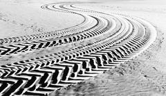 tire tracks prints in beach sand - stock photo