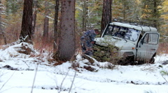 Russian off-road vehicle Uaz 469 on winter road in siberian Altay forest Stock Footage