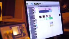 Computer monitor with music graphic equalizers in sound room production Stock Footage