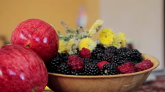 Adding Blackberry to the Bowl Stock Footage