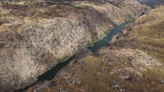 Aerial view descending camera to cliff in Duero River, Spain Stock Footage