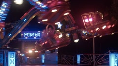 The turning roundabout at night in an amusement park - stock footage