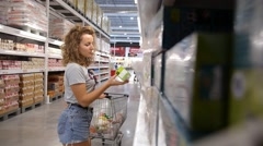Beautiful Young Woman Shopping in Supermarket - stock footage