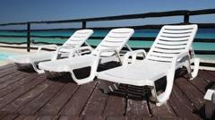 Sunbeds  near swimming pool Stock Footage