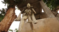 Monkey God  also known as Lord Hanuman statue in front of temple in India Stock Footage