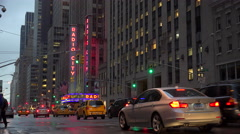 A nice establishing shot of Radio City Music Hall in New York City with traffic Stock Footage