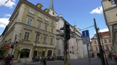 Relaxing at U Schnellu Restaurant next to Church of St. Thomas, Prague Stock Footage