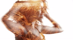 Double Exposure of afro girl spinning over golden fields Stock Footage
