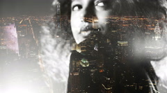 Afro girl double exposed over new york at night with city lights Stock Footage