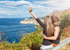 Happy couple enoying the view of Dubrovnik on their travels - stock photo