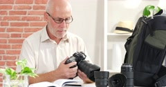 a man reads the manual of your camera - stock footage
