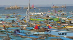 Men fixing fisher net in harbour,Pangandaran,Java,Indonesia Stock Footage