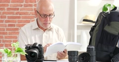 A man reads the manual of your camera Stock Footage