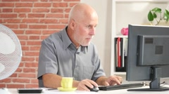 Mature businessman being occupied with computer work in the office Stock Footage