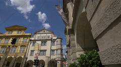 Old buildings and street indicators in Lesser Town Square, Prague Stock Footage