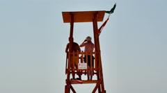 LifeGuard Beach Tower 4K Life Guard Stock Footage