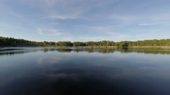 Pan across still mirror lake in Stockholm archipelago. Stock Footage