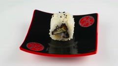 Chicken sushi roll on black plate Stock Footage