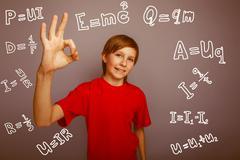 Teenage boy showing OK  sign genius physics formulas infographic Kuvituskuvat