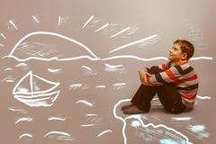 Teenager boy sitting by the sea cliff rock, infographics and chi Kuvituskuvat