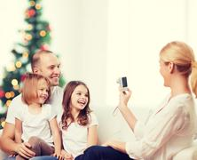 Happy family with camera at home Stock Photos