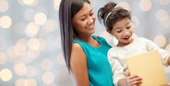 happy mother and child with gift box - stock photo