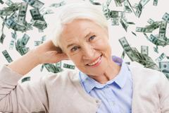 Stock Photo of happy senior woman face over violet background