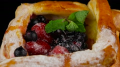 Puff pastry with berries rotating, closeup (loop) Stock Footage