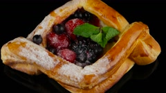 Stock Video Footage of puff pastry with berries and mint rotating (loop)