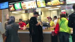 shoppers and tourists at McDonald's. - stock footage
