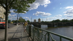 Walking on Smetana embankment, near the Legion Bridge in Prague Stock Footage