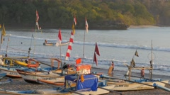 Beach with fisher boats and boat leaving,Pangandaran,Java,Indonesia Stock Footage