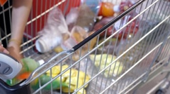 Cashier at Cash Desk with Trolley in Supermarket Arkistovideo